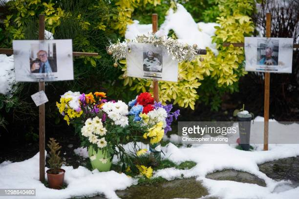 Photographs and memorials for those who died during the pandemic sit outside Riverside Church on January 26, 2021 in Burton, England. The memorial...