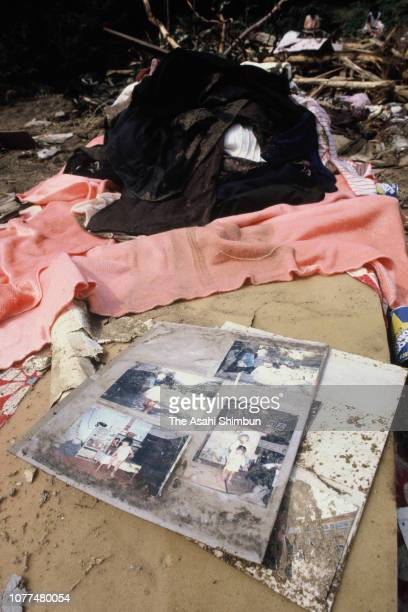 Photographs are seen at a place their house used to stand after a landslide is seen triggered by Typhoon Bess hits across Japan on August 4, 1982 in...