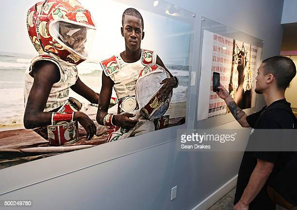 Photographs by Alexis Peskine on display at the PRIZM art fair in the Little Haiti art district during Art Basel Miami Beach on December 05 2015 in...