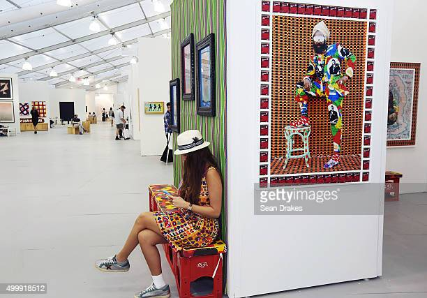 Photographs by Hassan Hajjaj on exhibit in the Taymour Grahne Gallery at the Untitled art fair during Art Basel Miami Beach in Miami Florida on...