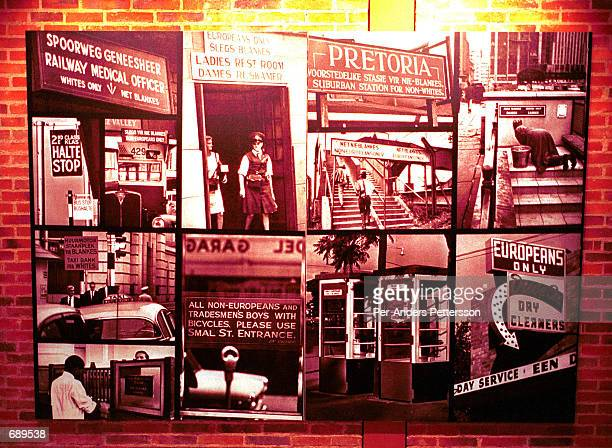 Photographs depicting the signs for whites and nonwhites are on display at the Apartheid Museum December 19 2001 in Johannesburg South Africa The...