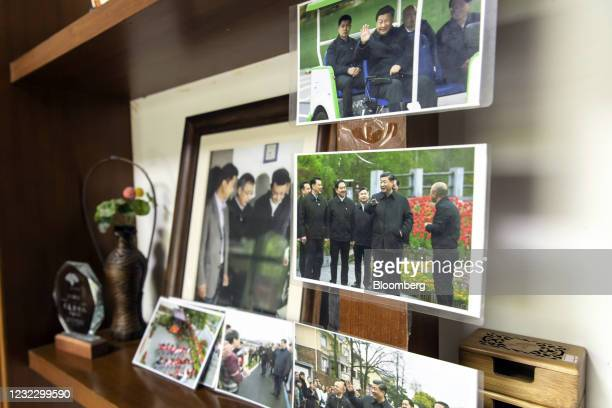 Photographs featuring Chinese President Xi Jinping during his visit to the region in 2005 inside a souvenir store at Yucun Village, Anji County,...