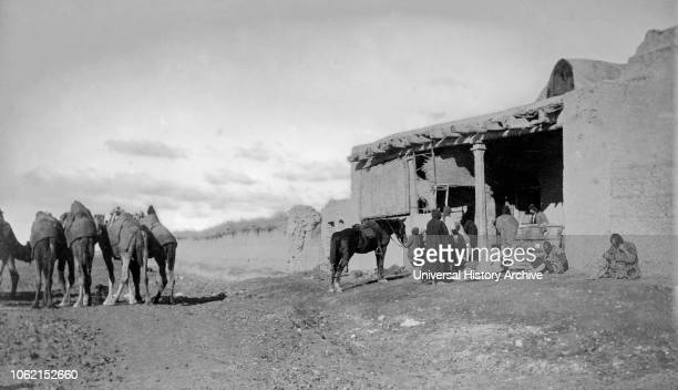WW1 photographs in Iraq Mesopotamia and surrounding areas British Royal Engineers The Baqubah Dispensary with a queue of people and camels Medicine...