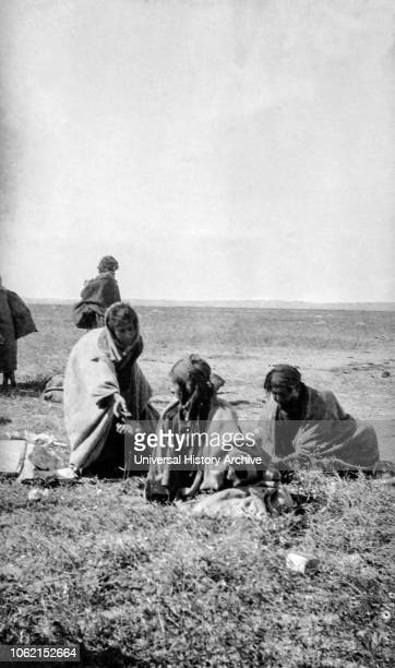 WW1 photographs in Iraq Mesopotamia and surrounding areas British Royal Engineers Baqubah Arabs collecting the spoils of war