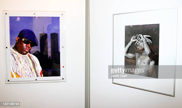 Photographs of Biggie and Tupac take by Chi Modu are seen at the Chi Modu exhibition opening at Smile Gallery on March 29 2012 in New York City