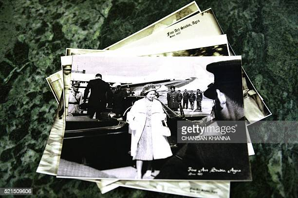 Photographs of Britain's Queen Elizabeth II taken by the late Kailash Nath Sharma are displayed on a table in Agra on April 15 2016 Prince William...