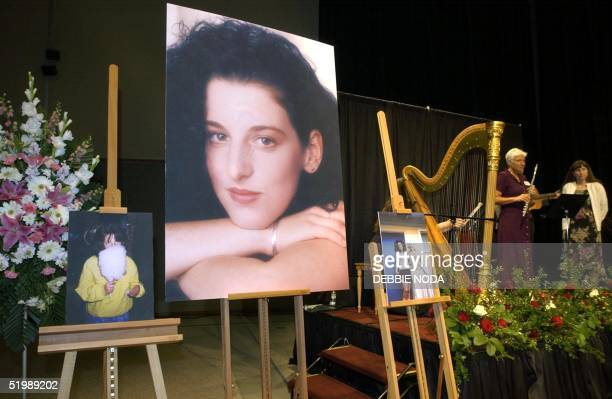 Photographs of Chandra Levy are displayed during a memorial for her at the Modesto Centre Plaza 28 May, 2002 in Modesto, CA. Levy, a young Washington...