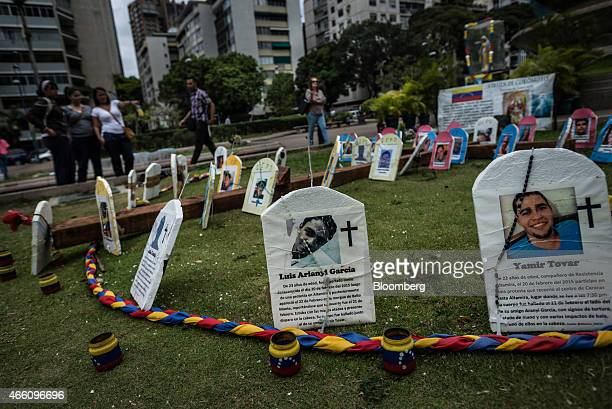 Photographs of deceased protestors Luis Arianyi Garcia and Yamir Tovar are displayed at a memorial in Altamira Plaza for opposition protesters who...