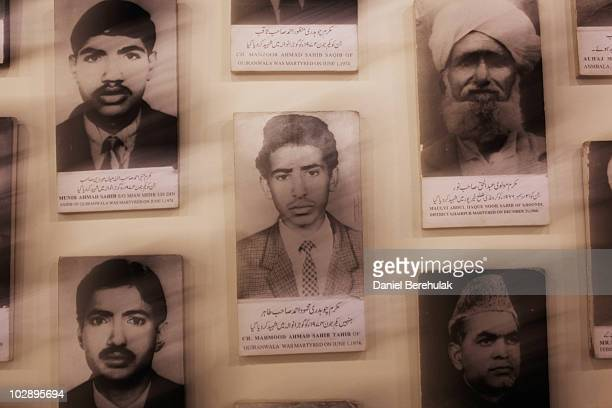 Photographs of martyrs from the persecuted Ahmadiyya community hang on a wall in the Ahmadiyya museum July 14 2010 in Chenab Nagar Pakistan The...