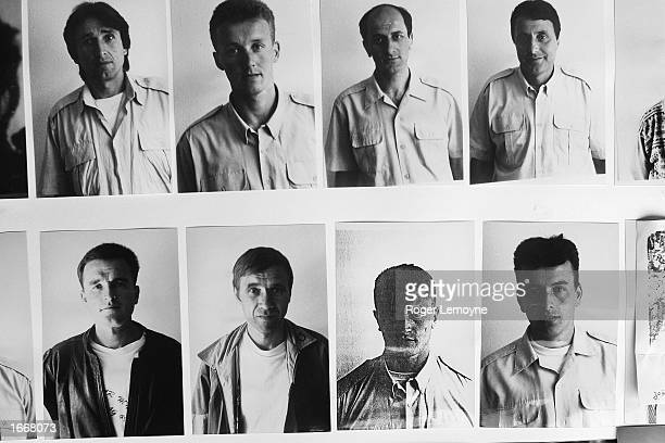 Photographs of missing men from Srebrenica are displayed in the office of the Srebrenica Widow's Association October 22, 2002 in Tuzla,...