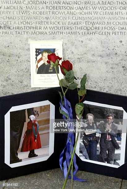 Photographs of New York Police Officer Moira Smith sit next to the Police Memorial in Washington, D.C., where her name, along with those of other...