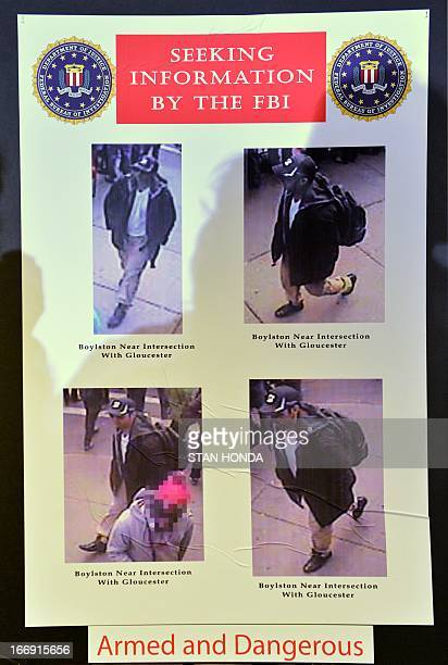 Photographs of one of two suspects wanted in the Boston Marathon bombings released by the FBI are shown at a press conference April 18 2013 in Boston...