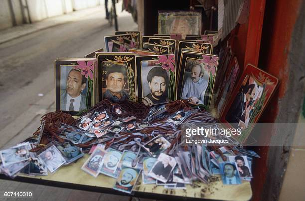 Photographs of Shiite leaders Nabi Berri Mousa Sadr and others are offered for sale in Beirut Lebanon as peace negotiations take place at the 1984...