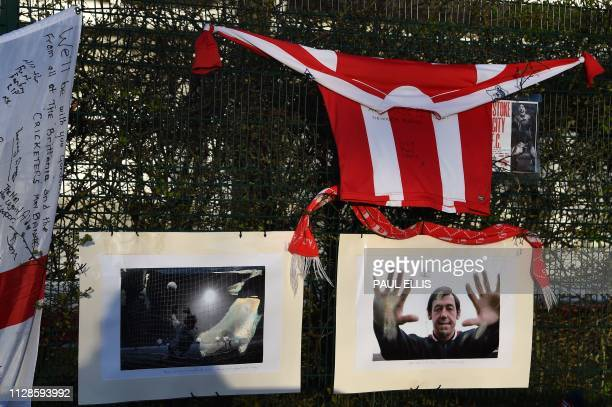 TOPSHOT Photographs of Stoke City and England's former goalkeeper Gordon Banks and other tributes honouring England's World Cup winning goalkeeper...