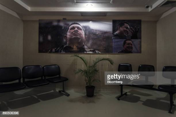 Photographs of the late Venezuelan president Hugo Chavez hangs on display in the waiting room for the Oncology Unit of the Luis Razetti University...