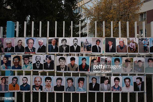 Photographs of the missing people of the 19981999 war are seen posted in the street on November 16 2007 in Pristina Kosovo Province Serbia Kosovo on...