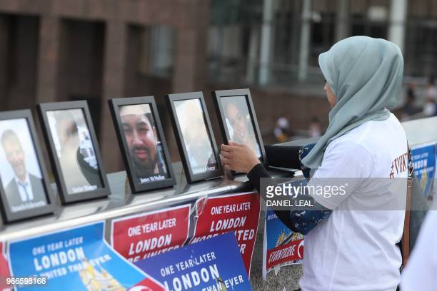 Photographs of the people killed in the London Bridge terror attack are placed as members of various faiths gather on London Bridge London on June 3...