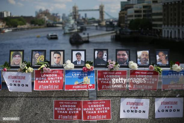 TOPSHOT Photographs of the people killed in the London Bridge terror attack are pictured on London Bridge London on June 3 prior to a commemoration...