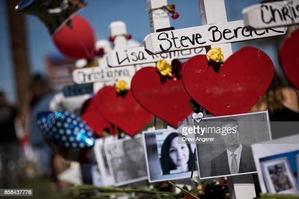 Photographs of the victims are included on some of the 58 white crosses for the victims of Sunday night's mass shooting on the south end of the Las...