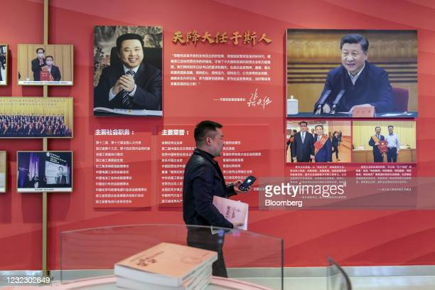 Photographs of Tianneng Battery Group Co. Chairman Zhang Tianren, left, and Chinese President Xi Jinping in an exhibition area during a media tour at...