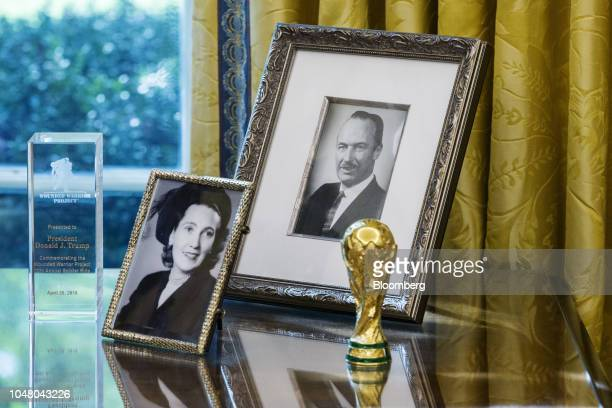 Photographs of US President Donald Trump's parents Mary Anne MacLeod Trump and Fred Trump sit on a desk during a meeting between Donald Trump and...