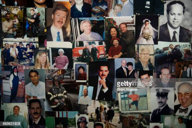 Photographs of victims are displayed in a room in the new 9/11 Tribute Museum June 13 2017 in New York City The new 9/11 Tribute Museum is officially...