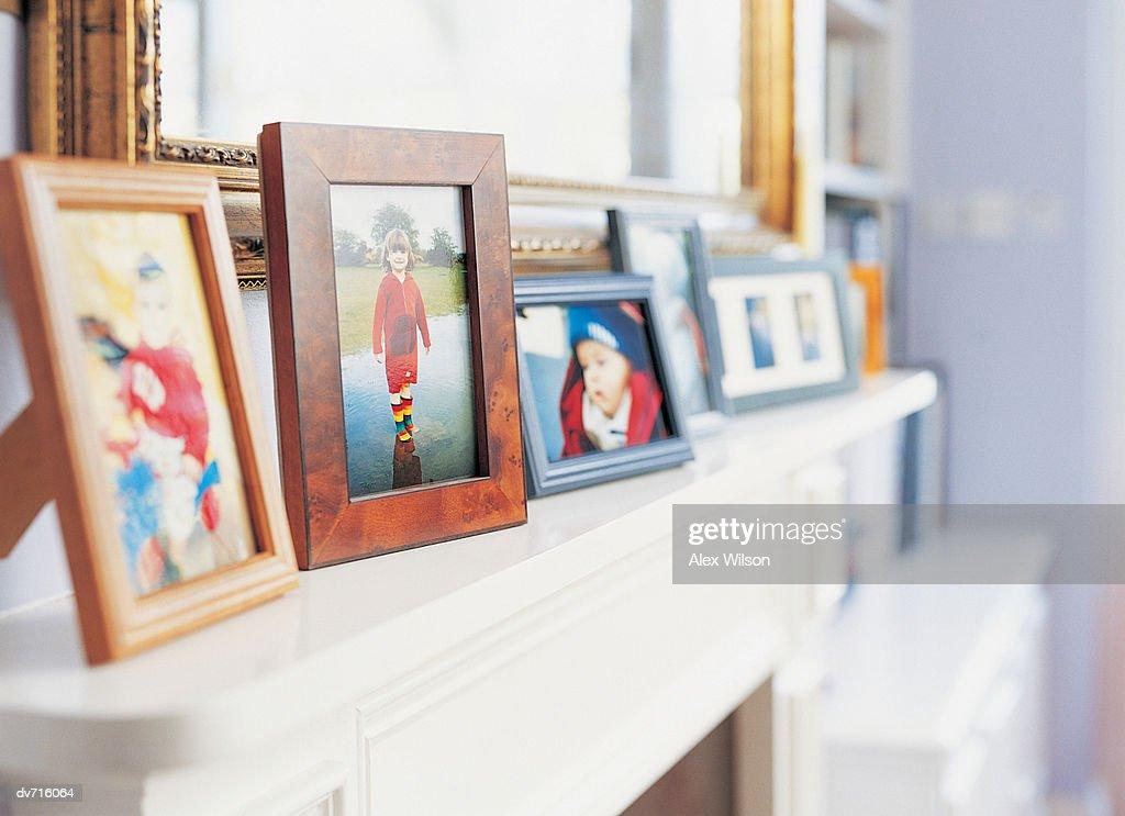 Photographs on a Mantelpiece : Stock Photo