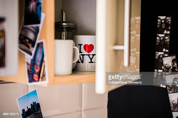 photographs on and around semi-opened kitchen cabinet - souvenir stock pictures, royalty-free photos & images