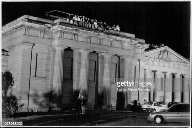 Photographs show scenes from the 1194 Gay and Lesbian Mardi Gras.Spectators on the supreme court roof, Taylor Square. March 05, 1994.