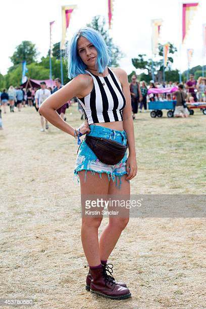 PARK ENGLAND Photography Assistant Caylee Hawkins wearing an American Apparel top Bambi and Manson shorts Doc Martens boots and a Vintage bag at...