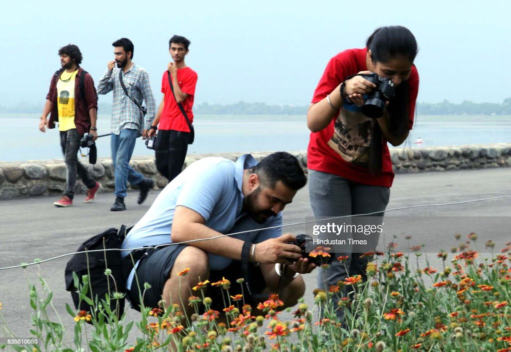 Photography enthusiasts take shots during a photo walk to mark World Photo Day at Sukhna Lake on August 19 2017 in Chandigarh India World Photography.