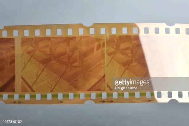 photography film negatives on 35 mm film - dia stock-fotos und bilder