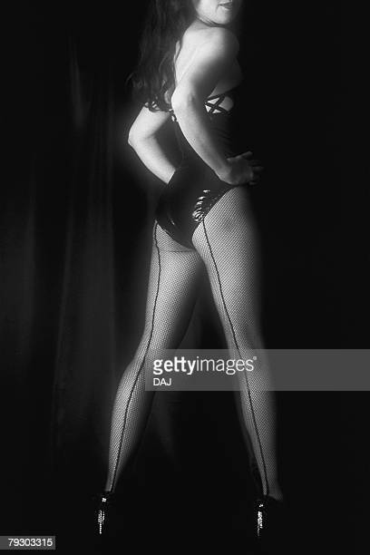 Photography of a woman dressed in black standing, Rear View, Black and White