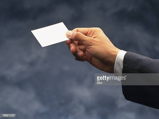 Photography of hand holding a business card, Side View