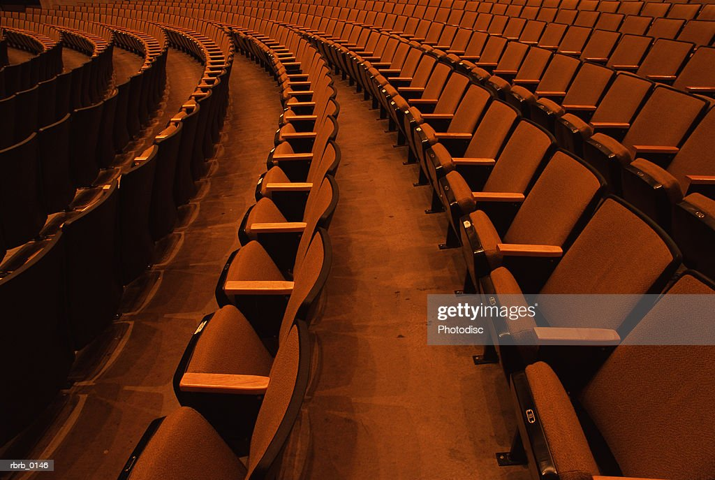 photography of rows of empty chairs in an auditorium : Stockfoto