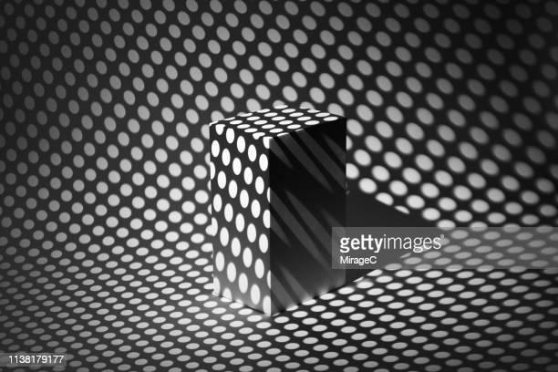 photography of spotted light casting cuboid shape - gezichtsbedrog stockfoto's en -beelden