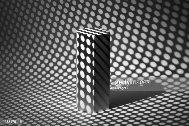 photography of spotted light casting hexagon shape - high contrast stock pictures, royalty-free photos & images