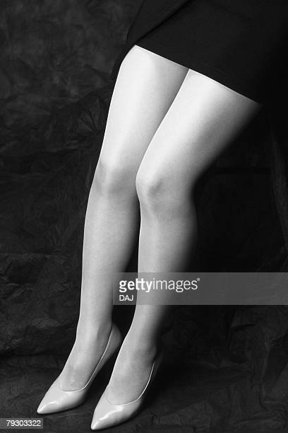 photography of womans legs, side view, black and white - japanese short skirts stock photos and pictures
