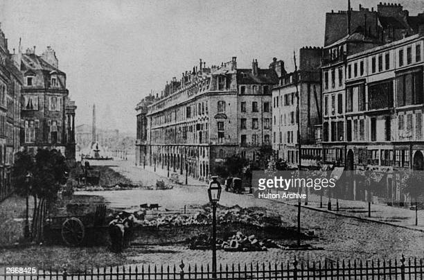 Photogravure of the remains of the barricades in the Rue Royale Paris near the Place de la Concorde the Corps Legislative and the Dome des Invalides