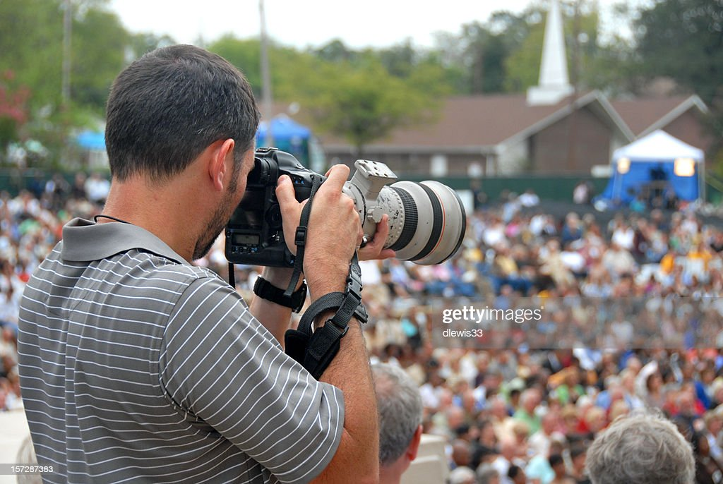 Photojournalist and Crowd of People : Stock Photo