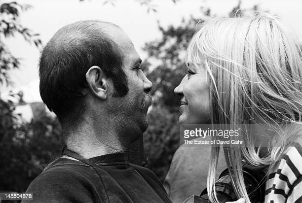 Photojournalist and famed rock photographer Barry Feinsteiin and folk singer Mary Travers backstage at the Newport Folk Festival in July 1965