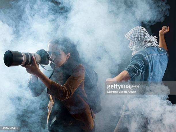 Photojournalist and protestor in tear gas smoke