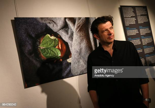 Photojournalist Damir Sagolj poses for a photo in front of his striking shot of a dead boy that has been chosen as Photo of the Year 2018 of Anadolu...