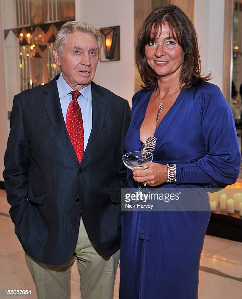 Photojournalist Don McCullin and Catherine Fairweather attend the Harper's Bazaar Woman of the Year Awards at Claridge's Hotel on October 31 2012 in...