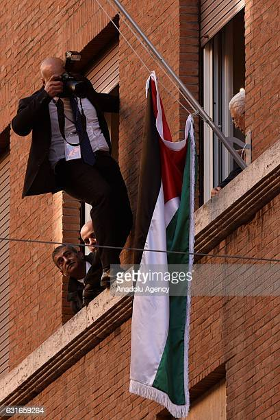 A photojournalist lean out of a window to take pictures as the Palestinian President Mahmoud Abbas and with Palestinian Ambassador Issa Kassissieh...