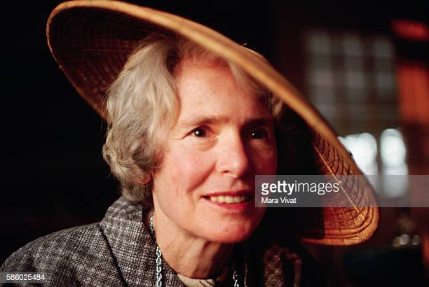Photojournalist Margaret BourkeWhite wears a Southeast Asian straw hat
