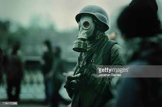 A photojournalist obesrves the scene as Egyptian protesters opposed to Egyptian president Mohamed Morsi clash with riot police near Tahrir Square on...