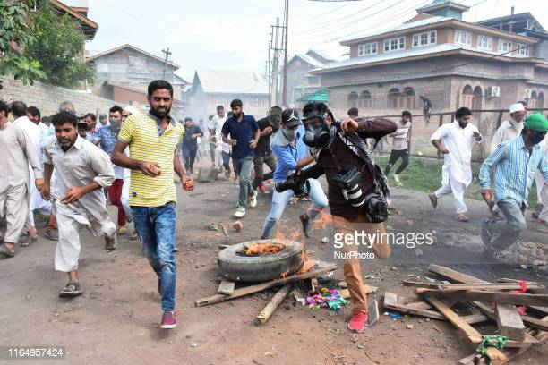 A Photojournalist runs for cover during clashes between people and Indian Forces in Srinagar Indian Administered Kashmir on 30 August 2019 Protests...