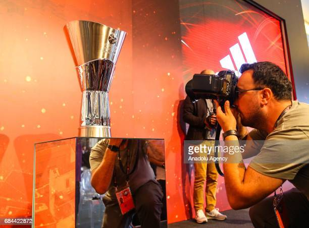 A photojournalist takes a photo of trophy during a press conference ahead of 2017 Turkish Airlines EuroLeague Final Four matches in Istanbul Turkey...