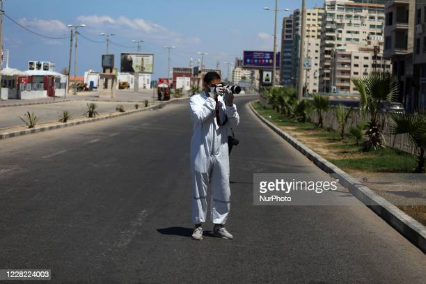 Photojournalist taking pictures during a lockdown imposed following the discovery of coronavirus cases in the Gaza Strip, Thursday, Aug. 27, 2020. On...